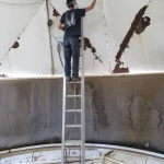 Trent scraping paint from the Test Module lung roof, SAM at Biosphere 2 - photo by Kai Staats