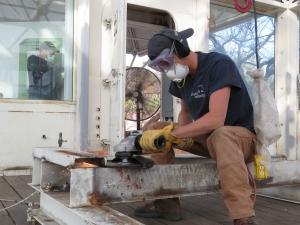 Trent Tresch disassembling the HVAC frame, SAM at B2