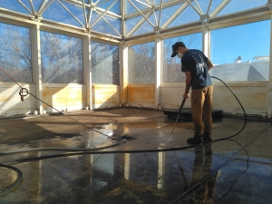 Trent Tresch power washing the floor, SAM at B2