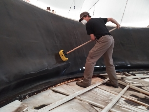 Kai Staats scrubbing the Hypalon membrane at SAM, Biosphere 2